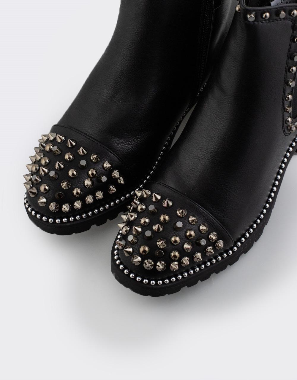 Εικόνα από Γυναικεία μποτάκια με τρουκς Μαύρο