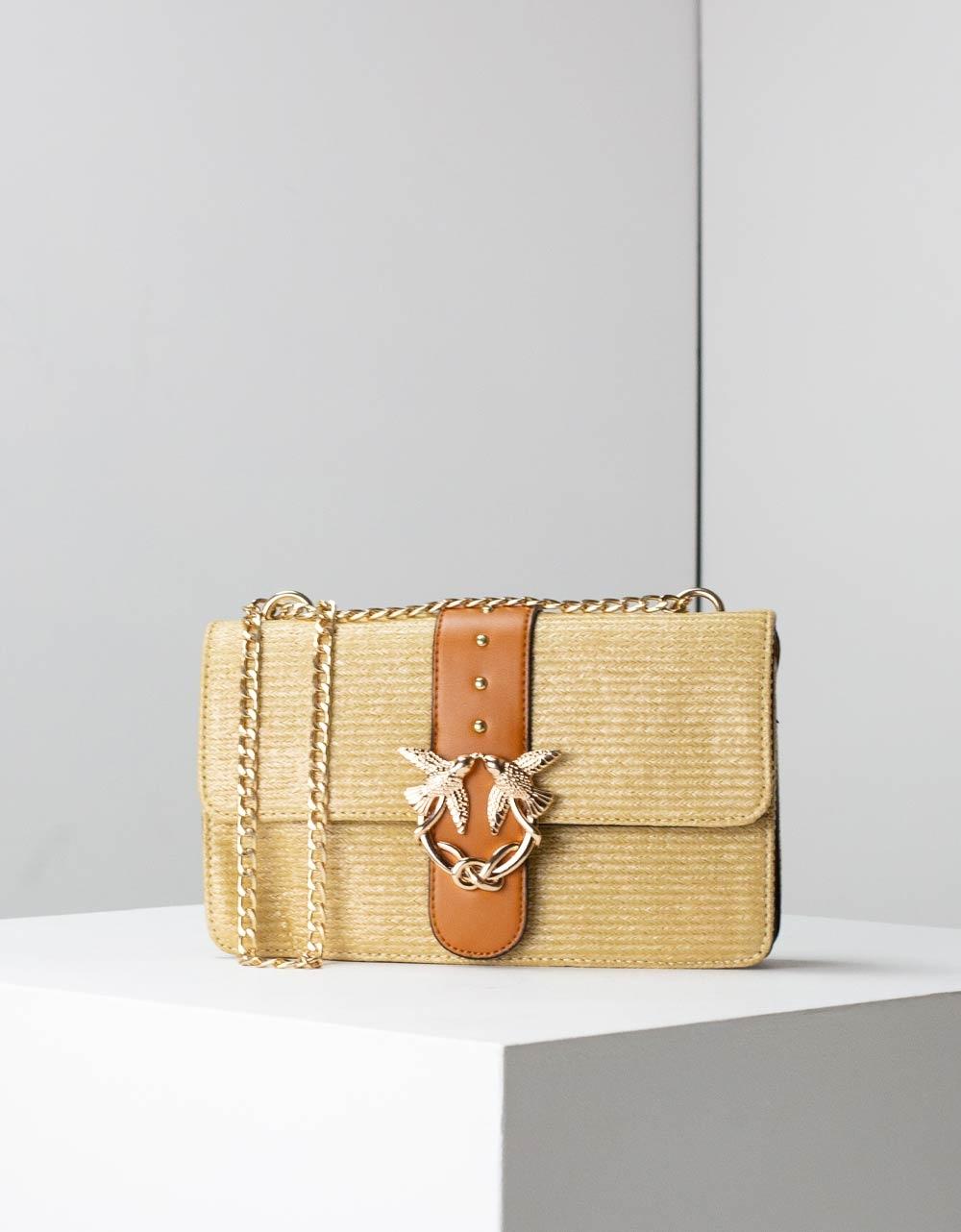 Εικόνα από Γυναικεία τσάντα ώμου ψάθα με διακοσμητικό κούμπωμα Πούρο