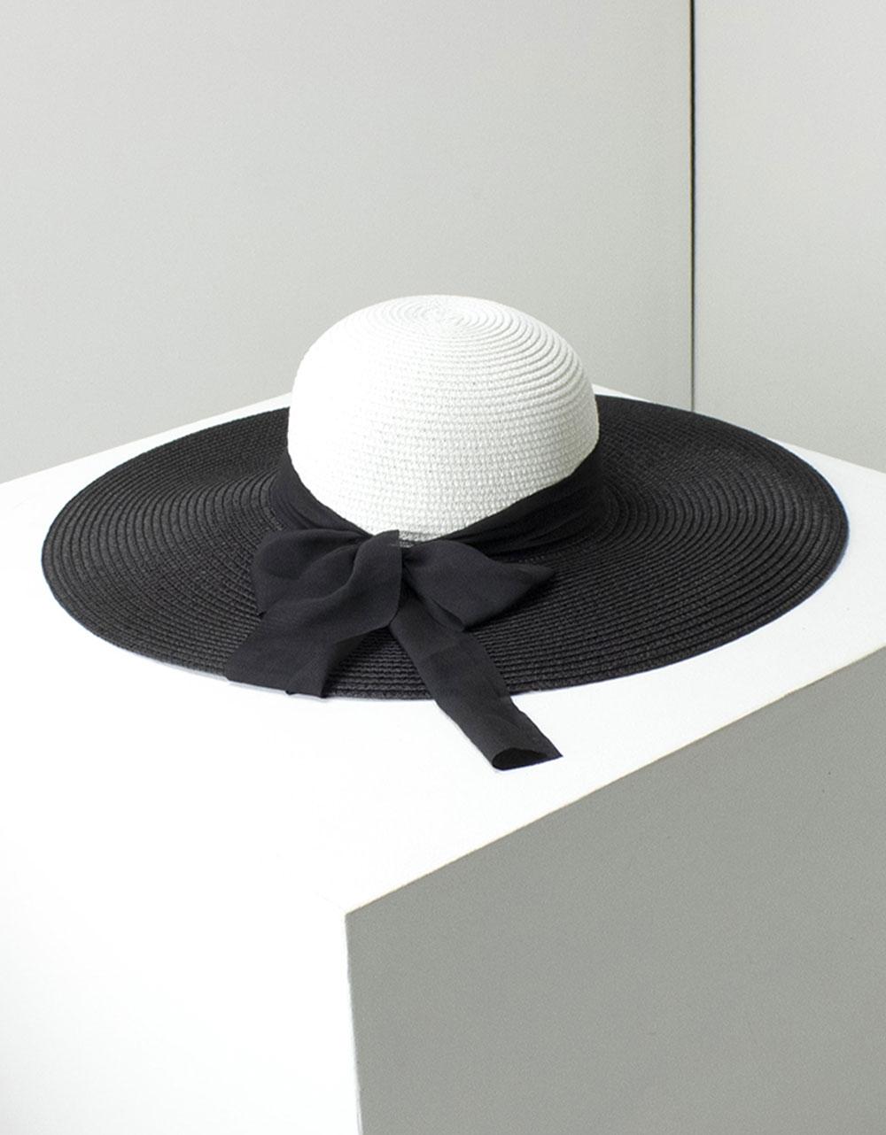 Εικόνα από Γυναικεία καπέλα δίχρωμα με φίογκο Λευκό/Μαύρο