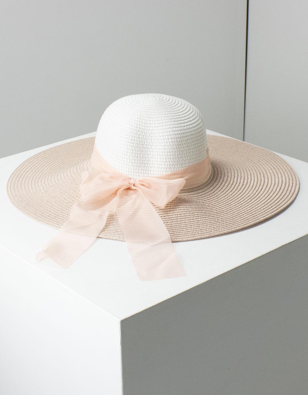 Εικόνα από Γυναικεία καπέλα δίχρωμα με φίογκο Λευκό/Ροζ