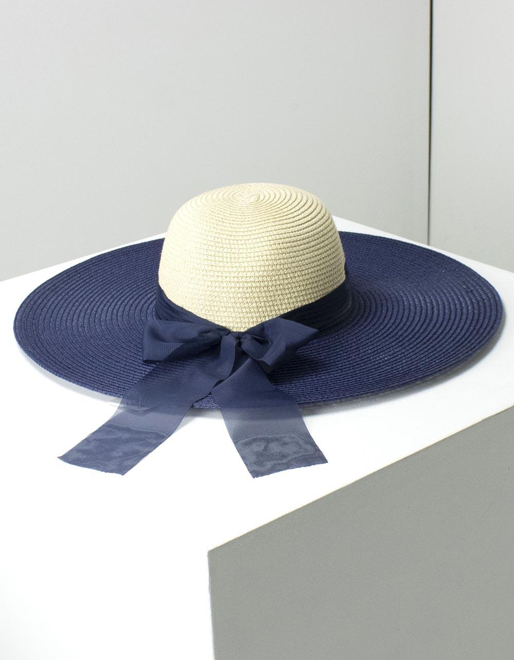Εικόνα από Γυναικεία καπέλα δίχρωμα με φίογκο Μπέζ/Μπλέ
