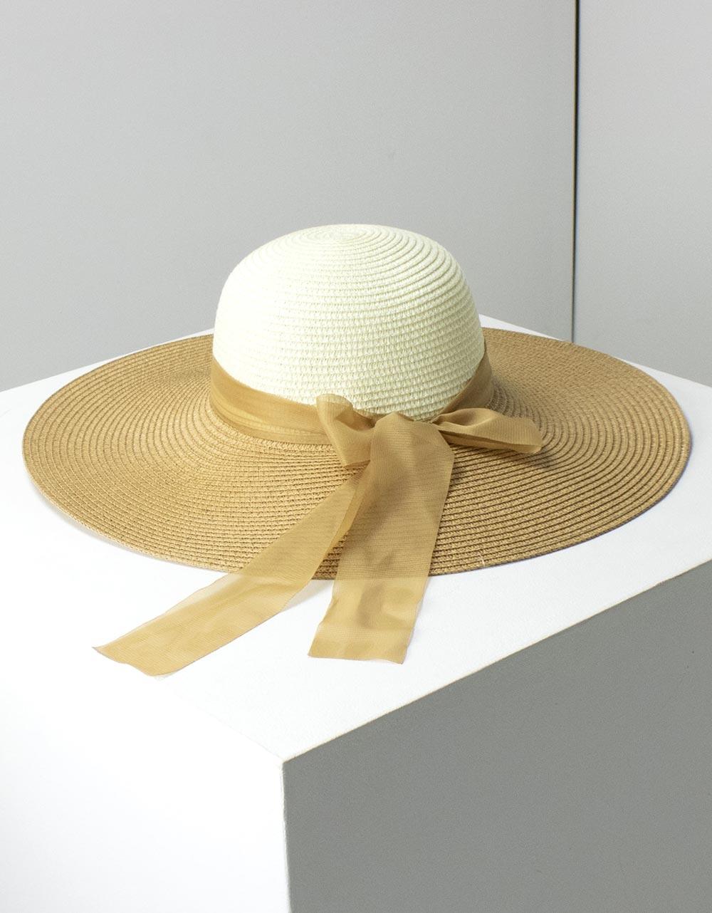 Εικόνα από Γυναικεία καπέλα δίχρωμα με φίογκο Μπέζ/Πούρο