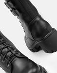 Εικόνα από Γυναικεία μποτάκια με διακόσμηση από μεταλλικά τρουκς Μαύρο