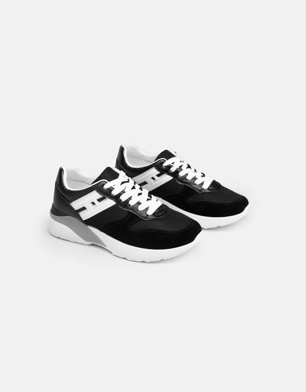 Εικόνα από Γυναικεία sneakers με δίχρωμες λεπτομέρειες Μαύρο/Λευκό