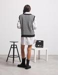 Εικόνα από Γυναικεία μπλούζα γιλέκο πλεκτό Μαύρο/Λευκό