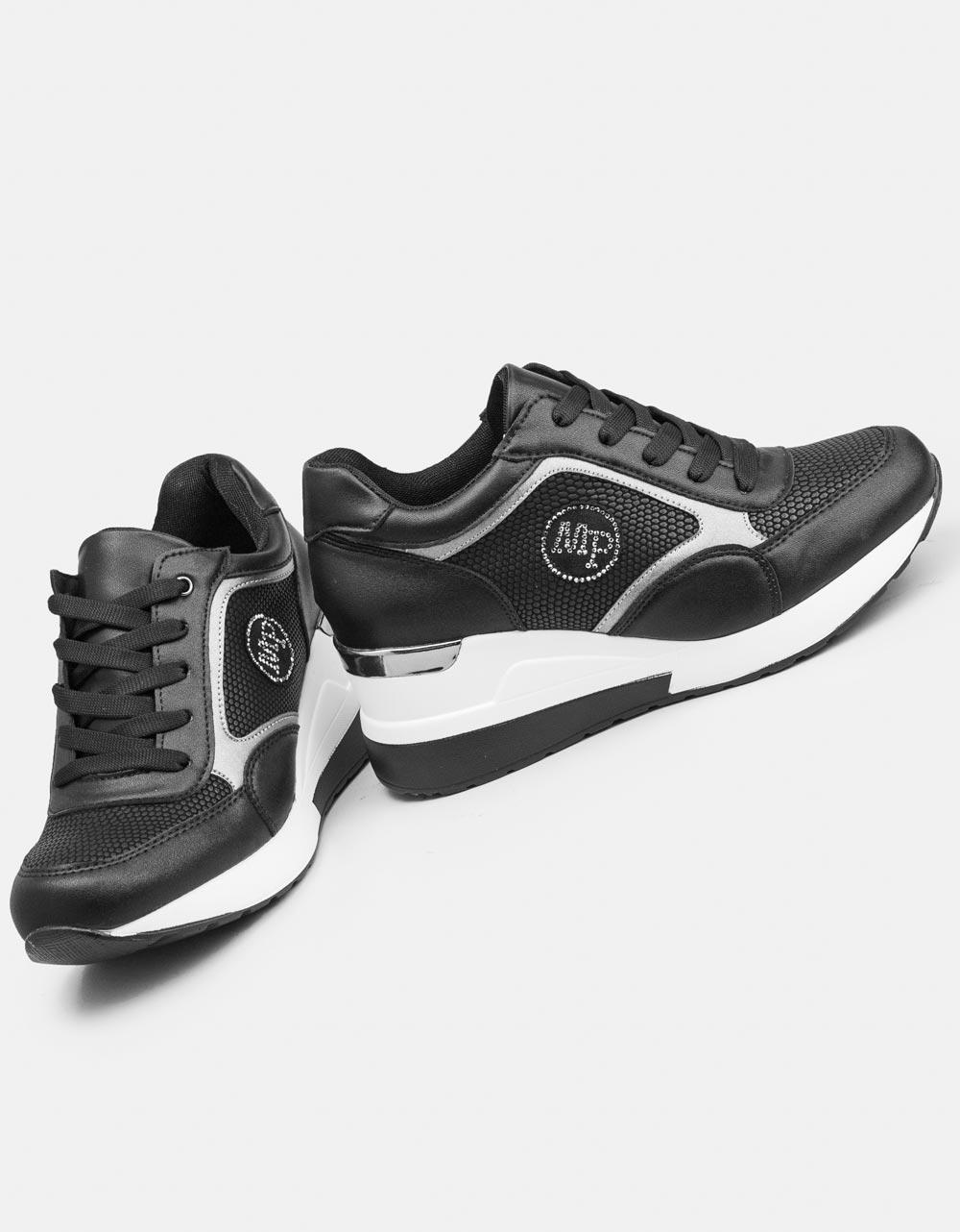 Εικόνα από Γυναικεία sneakers με τακούνι και μεταλλική λεπτομέρεια Μαύρο