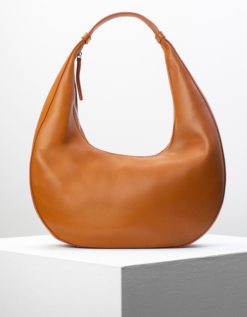 Εικόνα από Γυναικεία τσάντα ώμου σε οβάλ σχήμα Ταμπά