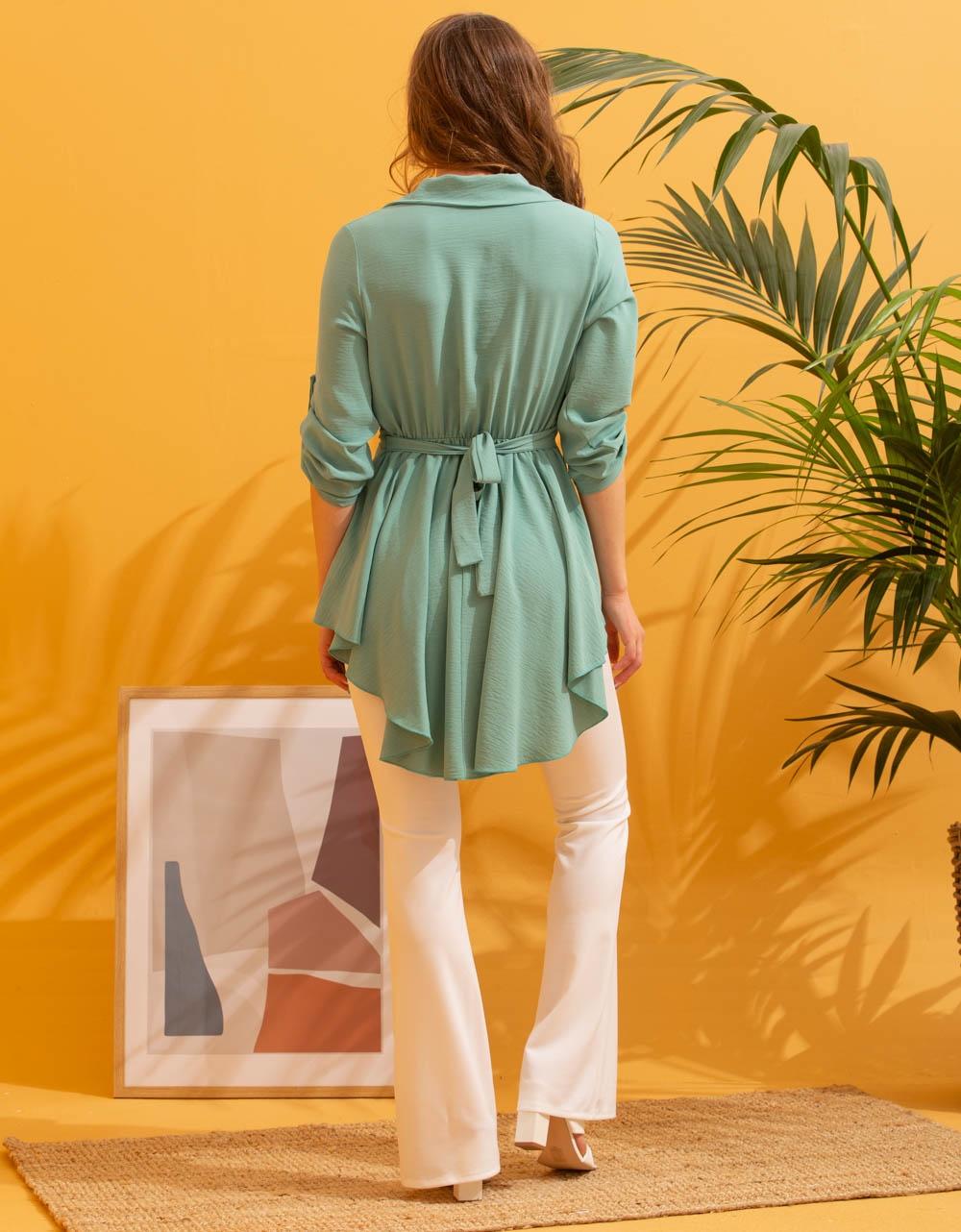 Εικόνα από Γυναικεία μπλούζα ασύμμετρη Τιρκουάζ