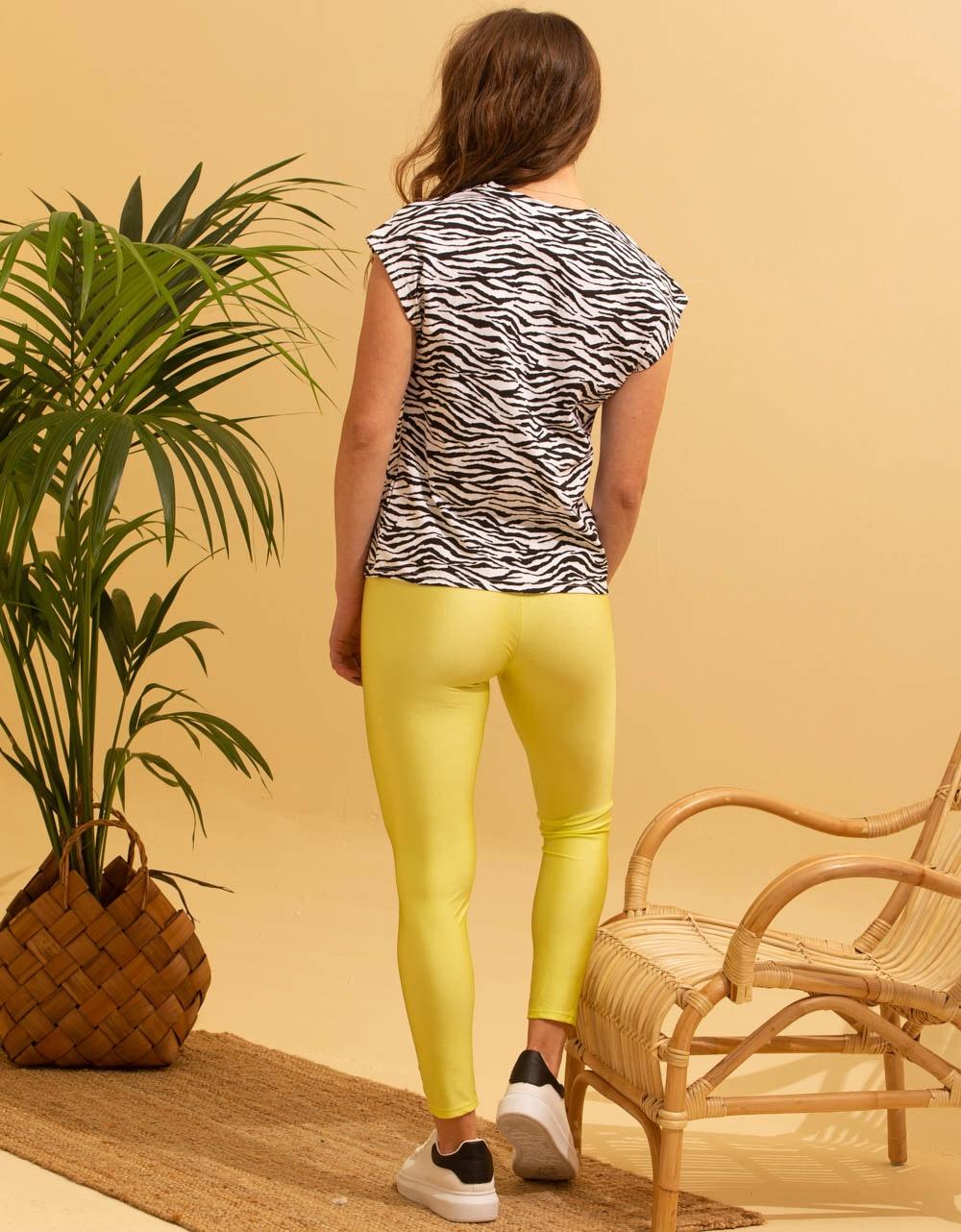 Εικόνα από Γυναικείο παντελόνι κολάν γυαλιστερό Κίτρινο