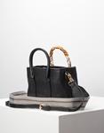 Εικόνα από Γυναικεία τσάντα χειρός με διακοσμητικό αξεσουάρ Μαύρο