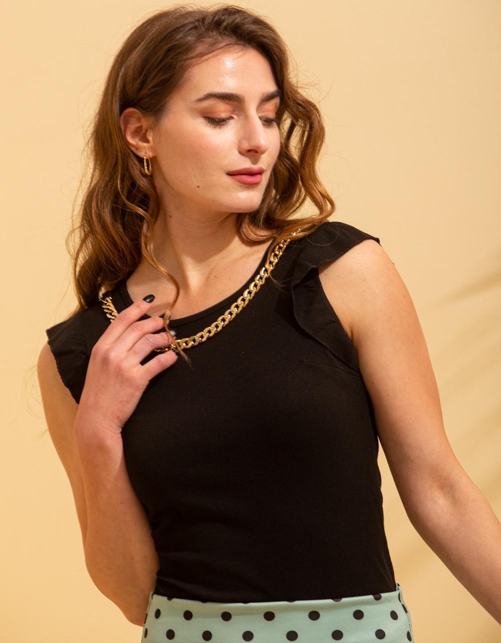 Εικόνα από Γυναικεία μπλούζα με βολάν στο μανίκι Μαύρο