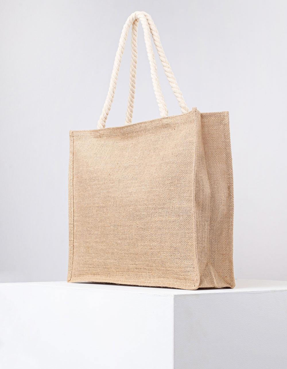 Εικόνα από Γυναικεία τσάντα χειρός ψάθινη με διακοσμητικό φουντάκι Μπεζ
