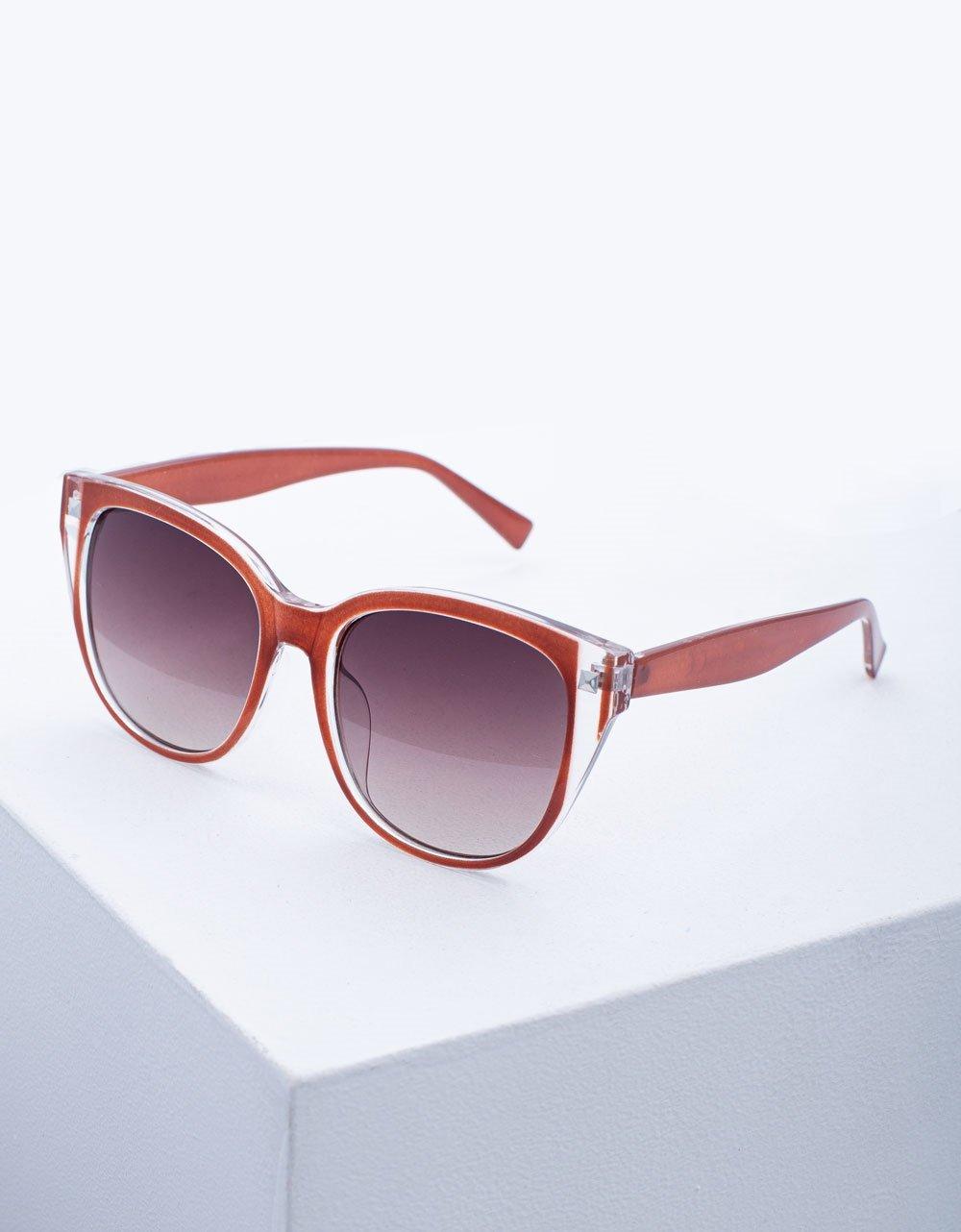 Εικόνα από Γυναικεία γυαλιά ηλίου σε στρογγυλό σχήμα Μπορντώ