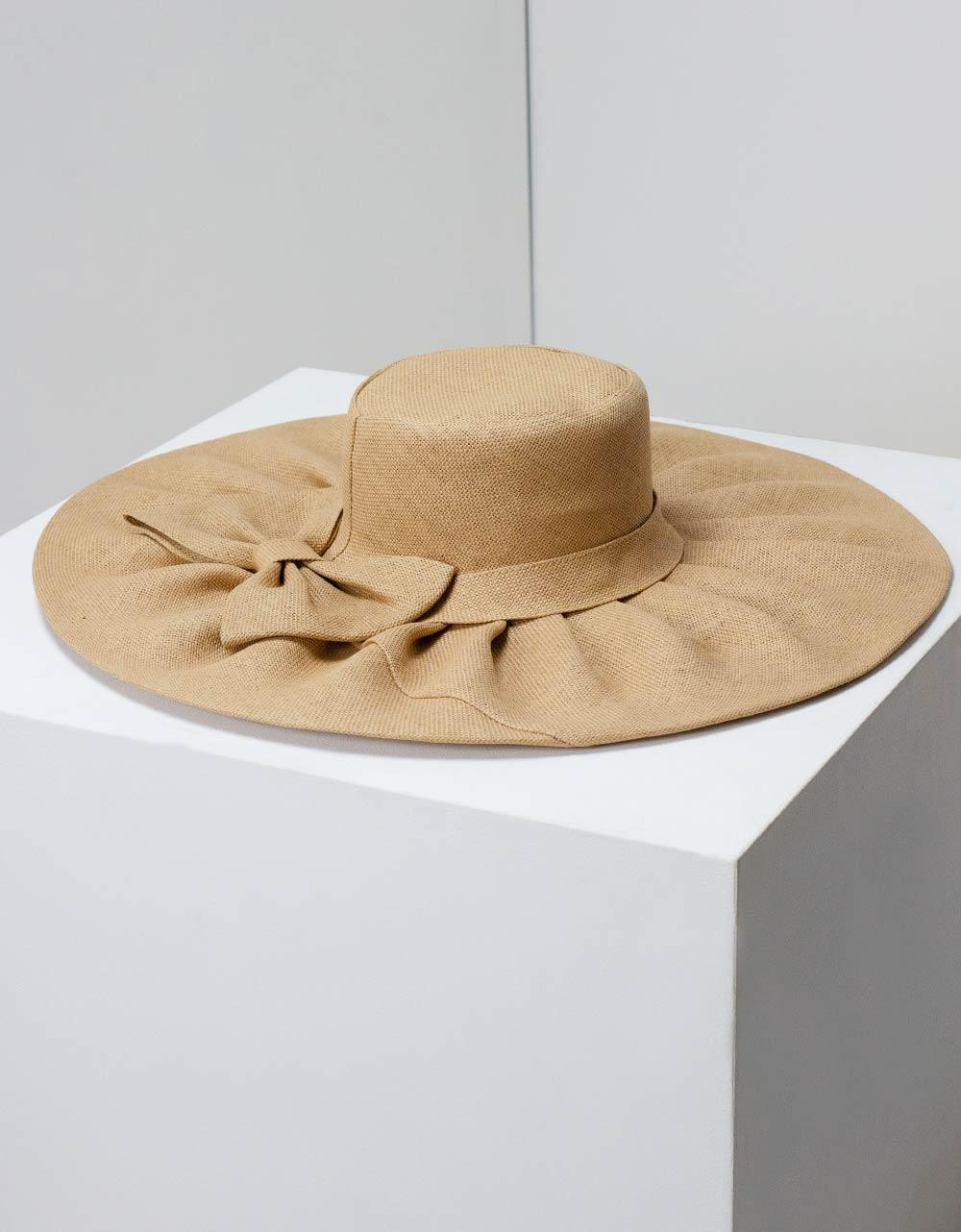 Εικόνα από Γυναικεία καπέλα με φιόγκο Πούρο
